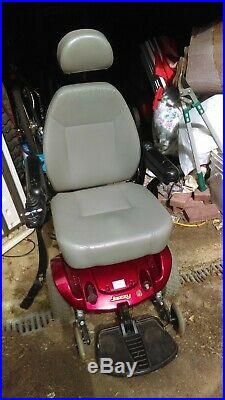 Jazzy red electric wheelchair/scooter older, new batteries, working charger